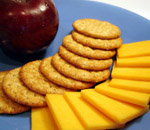 crackers and cheese with an apple