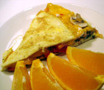 Vegetarian Omelet with orange slices